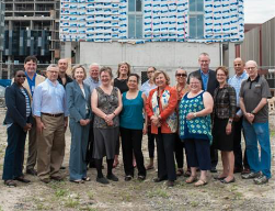 Fred Victor board members and senior staff proudly standing in front of of 20 Palace Street Affordable Housing during groundbreaking ceremony. Fred Victor is the leader in ending homelessness in Toronto.