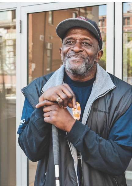 A man is happy and proud to have a place to call home. Your donations help people who are homeless.