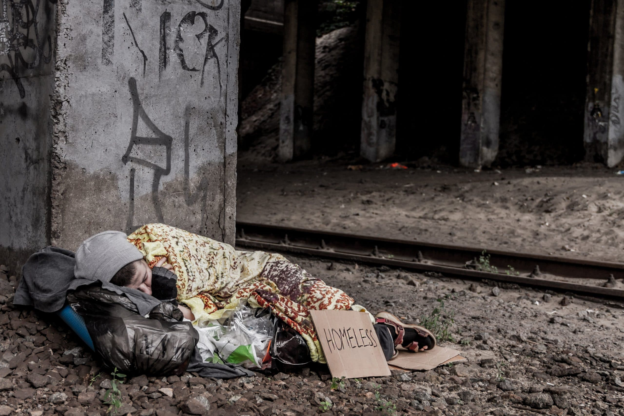 A homeless person sleeping outdoors