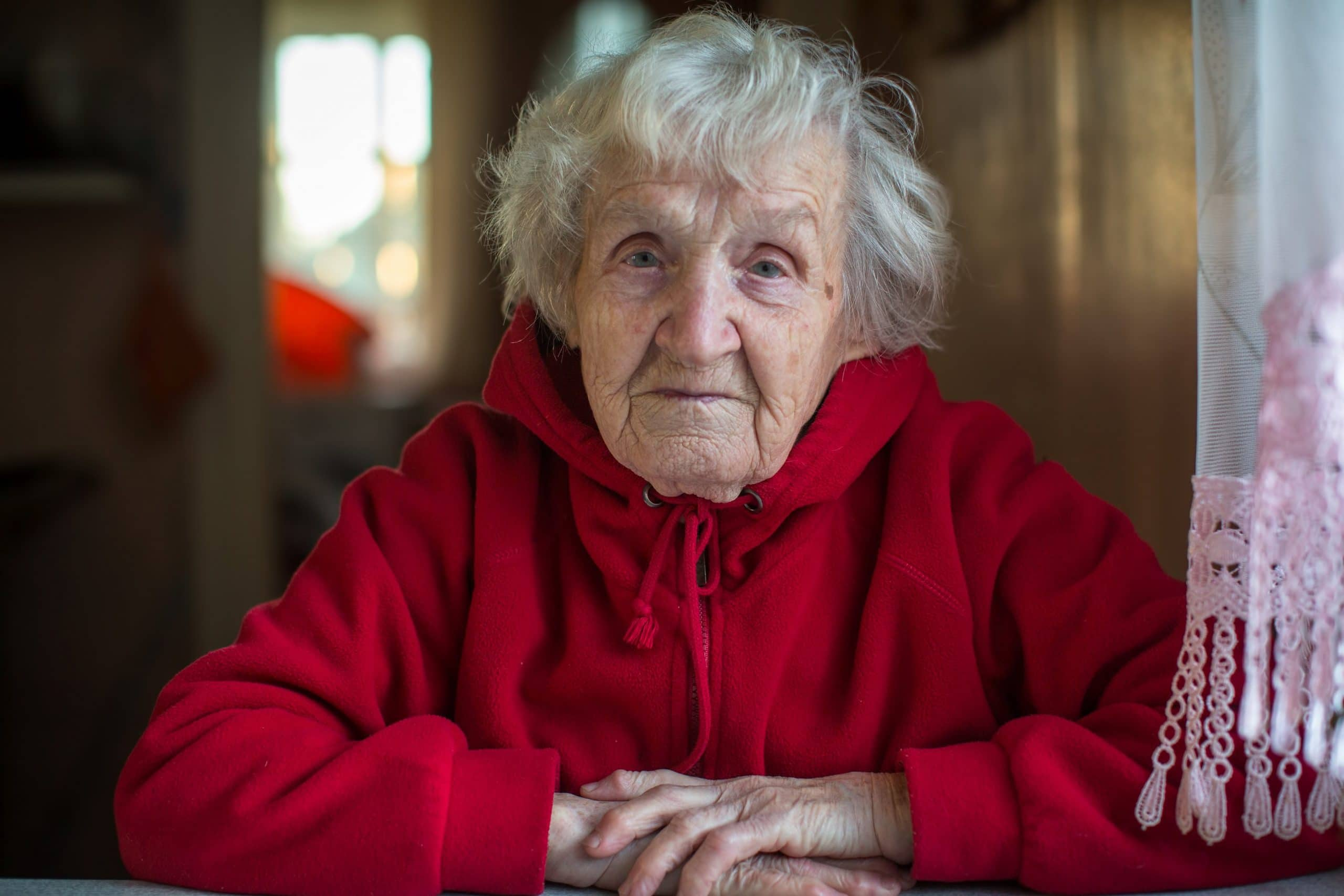 Lonely senior women in red sweater