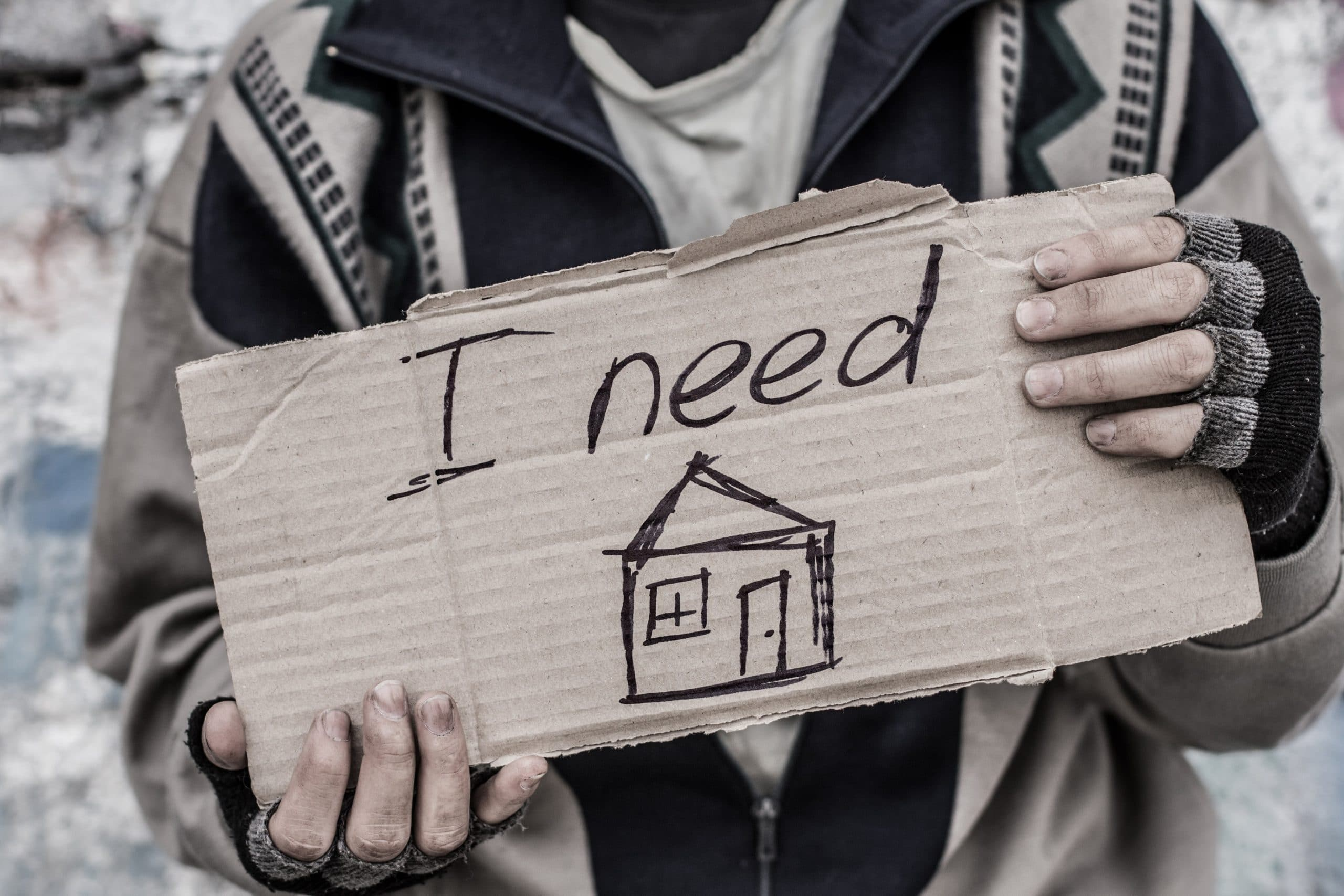 Homeless holding a sign I need Home