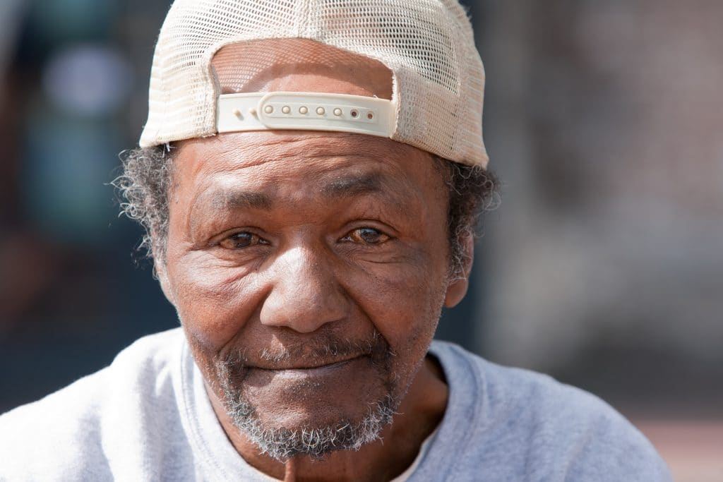 A portrait of Afro american homeless man