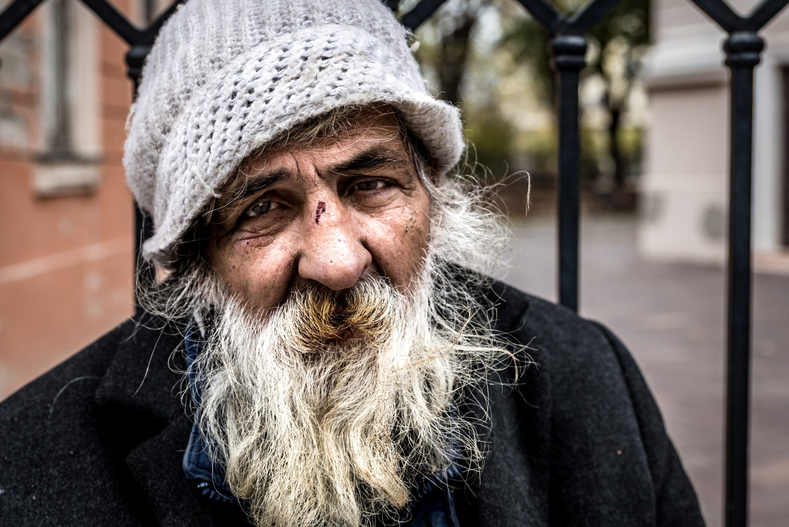Close up portrait of old homeless