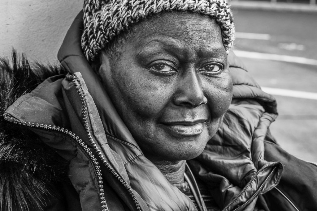 Black homeless woman on the street