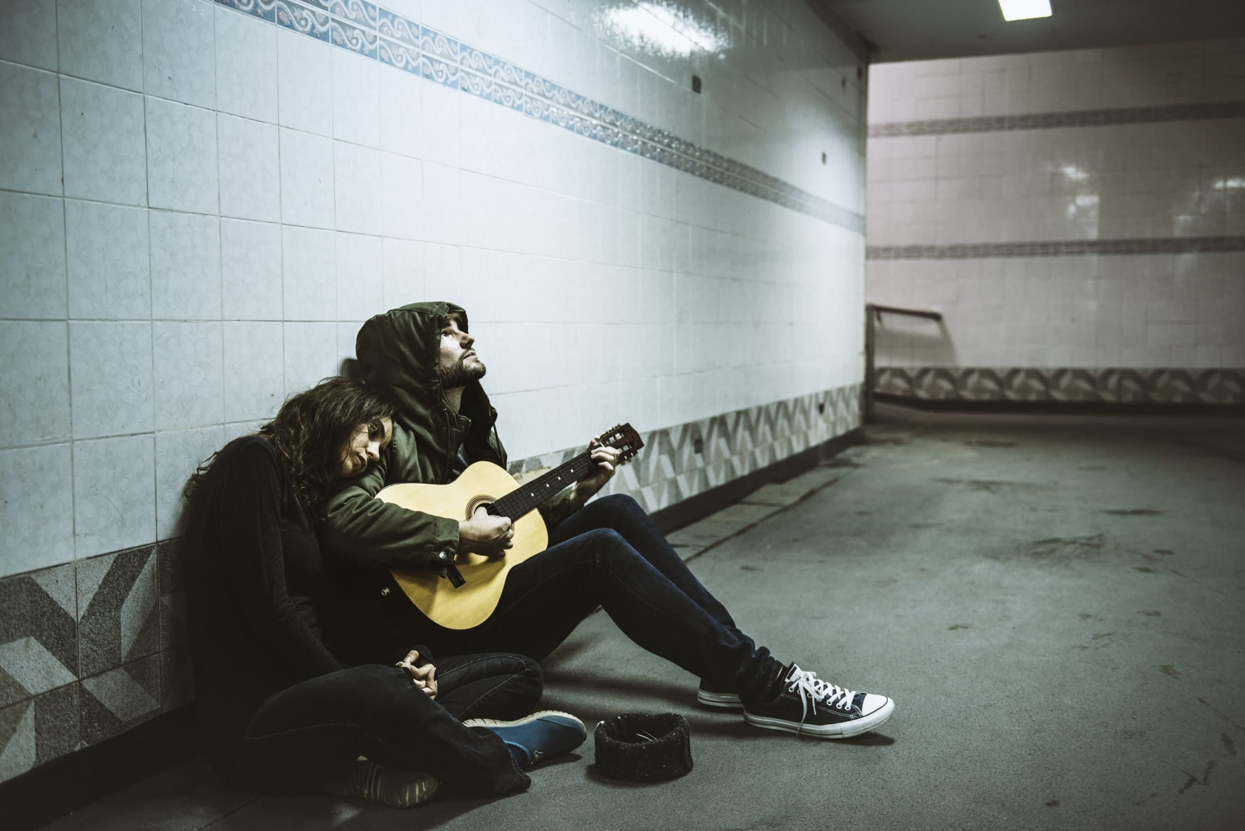 Homeless couple in the underground