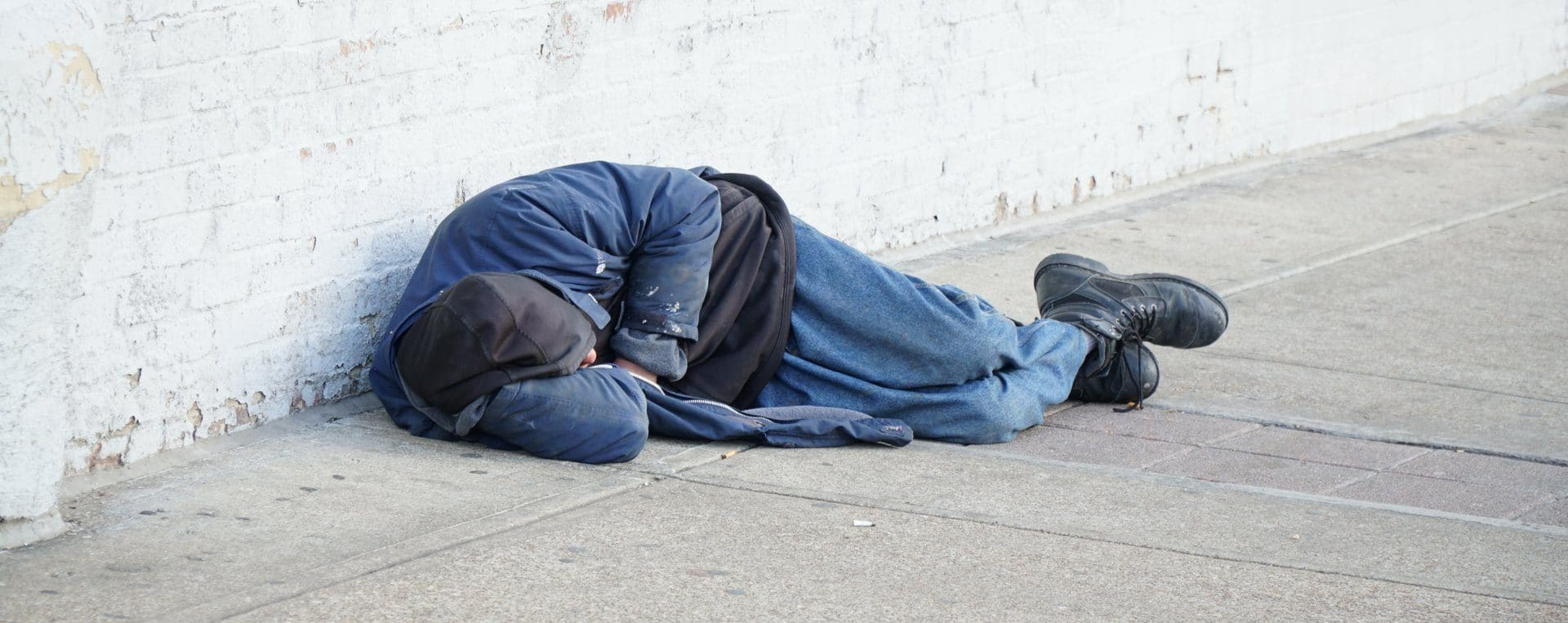 Homeless person sleeping on the street during COVID 19 outbreak