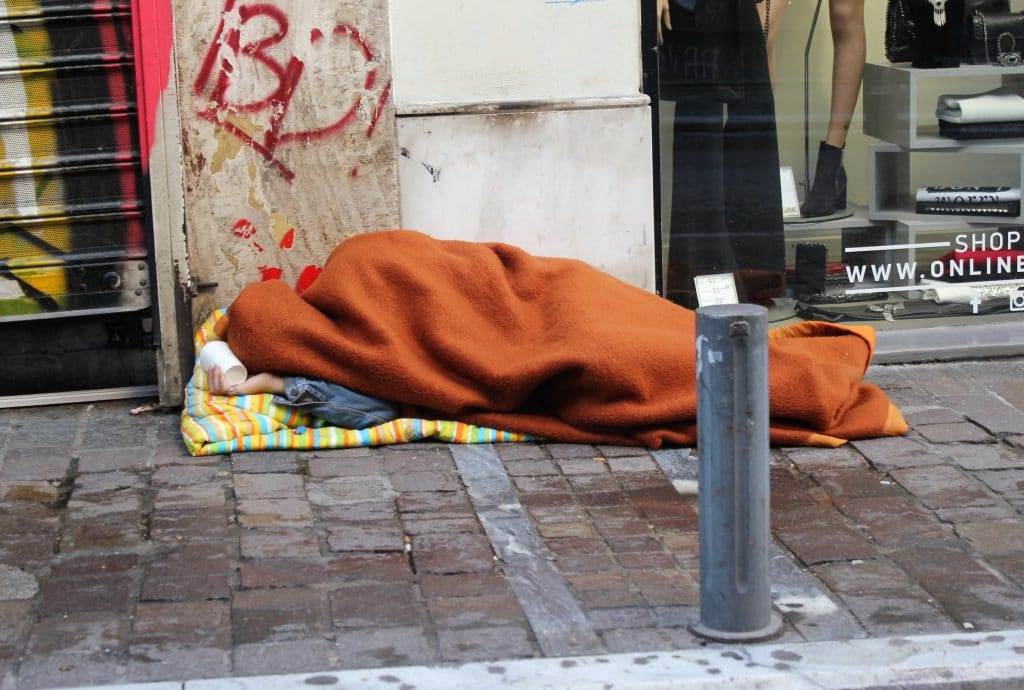 Homeless person sleeping out on the street