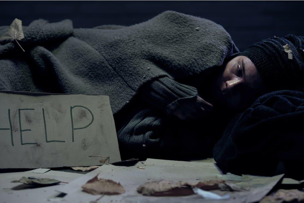 A homeless woman sleeping outdoors