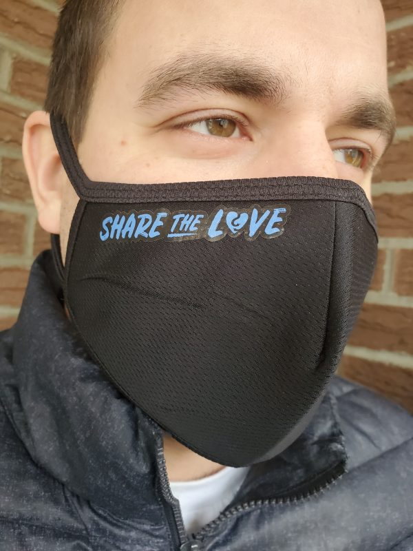 A man wearing Share The Love facemask in support of Fred Victor