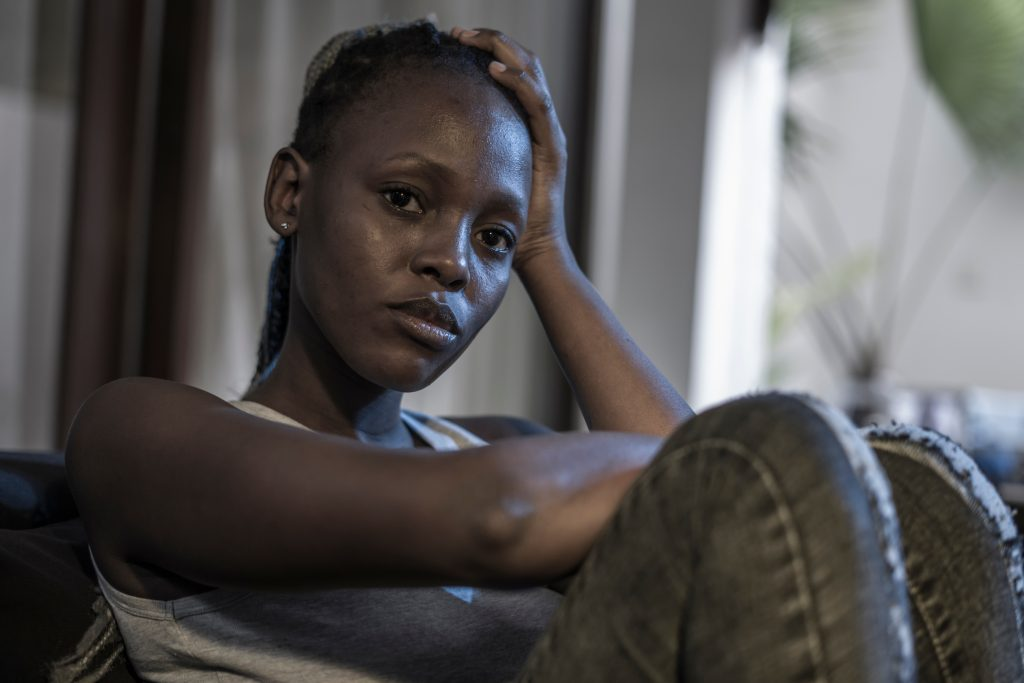 Young black woman sad and depressed