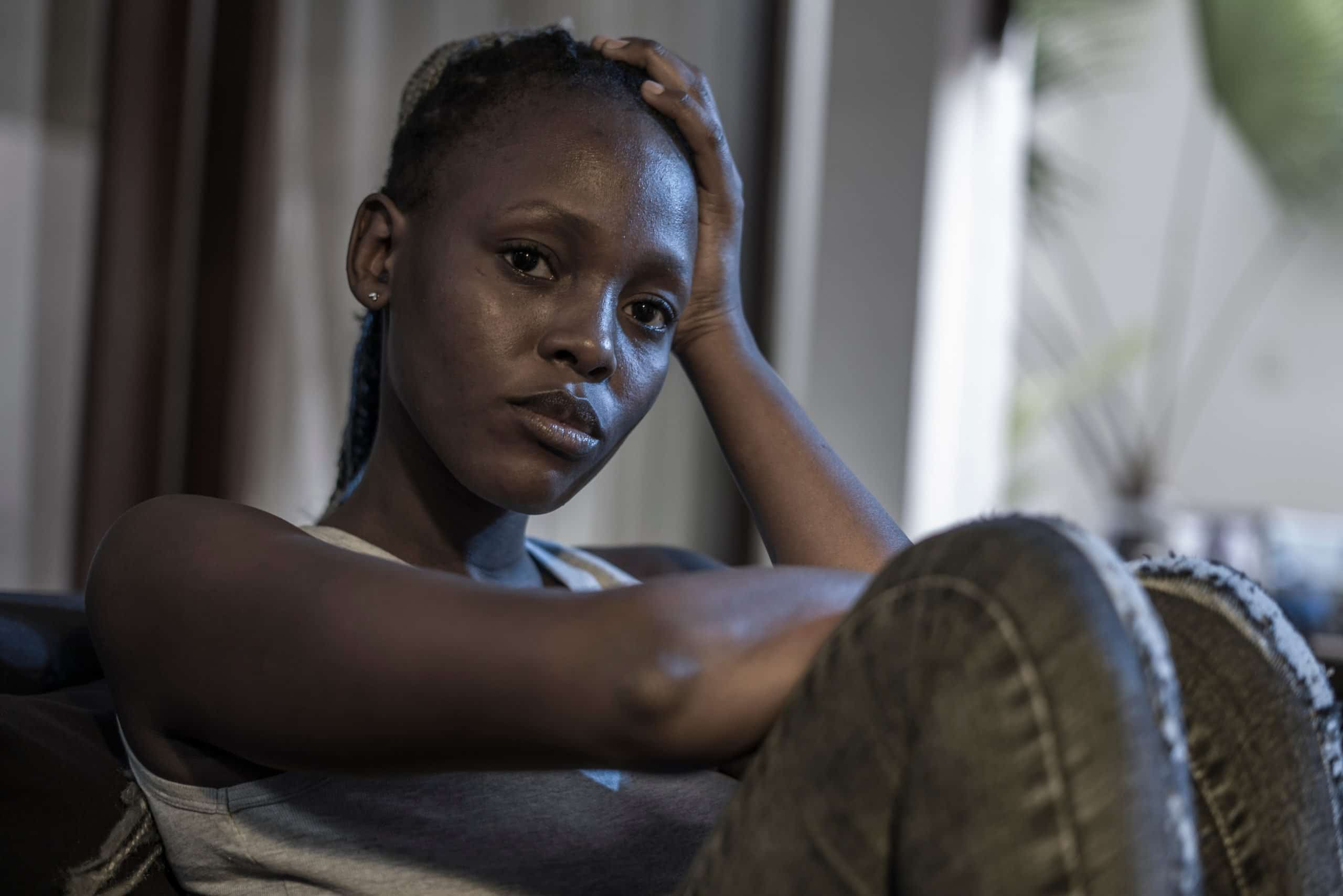 Afro Canadian Woman Sitting Depressed