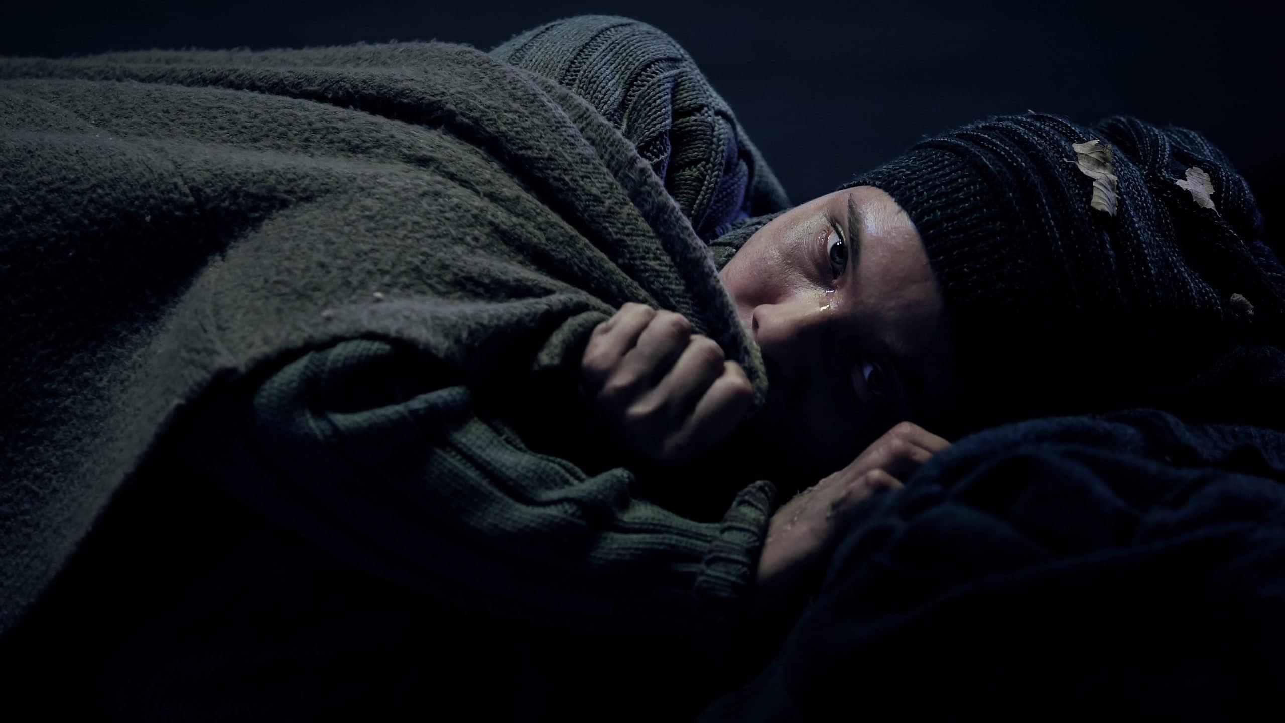 A homeless woman sleeping outdoors during the pandemic