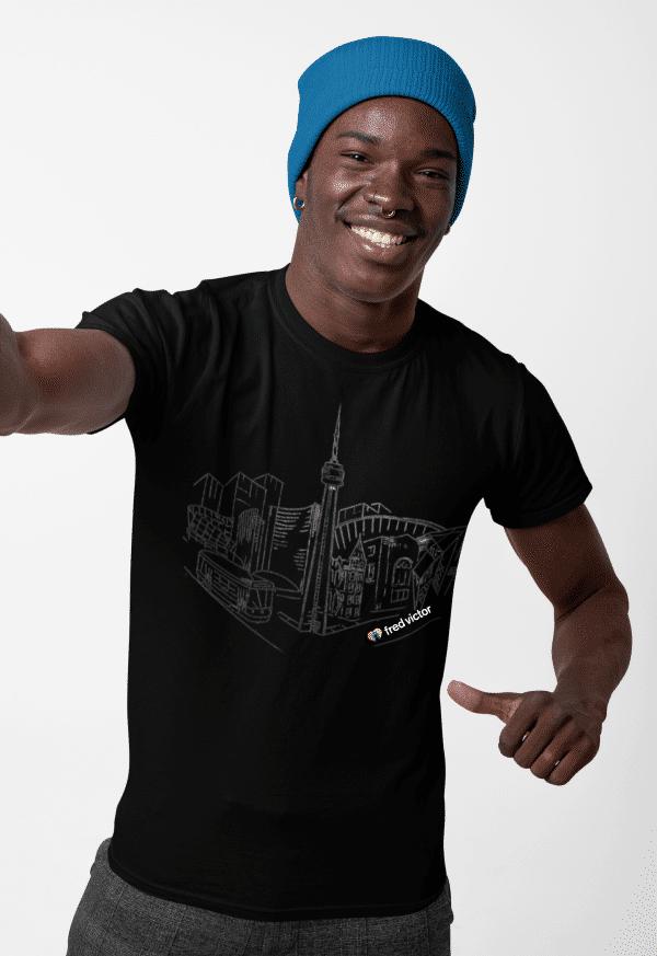 Black man smiling and wearing Toronto design t-shirt