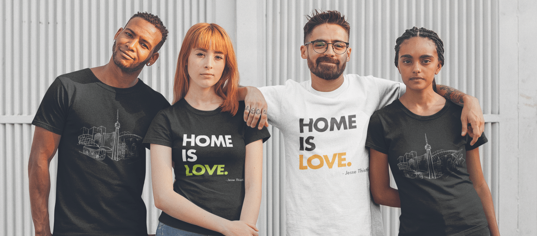 Four people wearing Fred Victors T shirts that support people experiencing homelessness